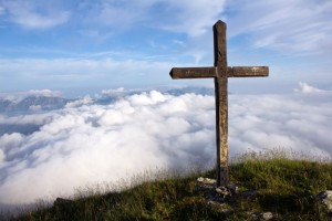 Summit Cross above clouds