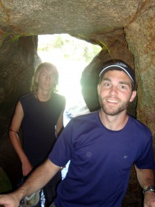 Brian and a youth explore a cave.